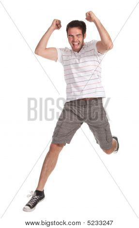 Young Happy Man Jumping On A White Background