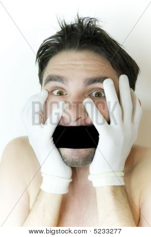 Scared Young Man With  Bandage On  Mouth