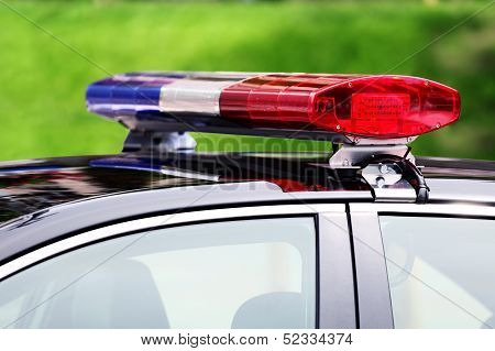 Police Car With Siren Light Closeup