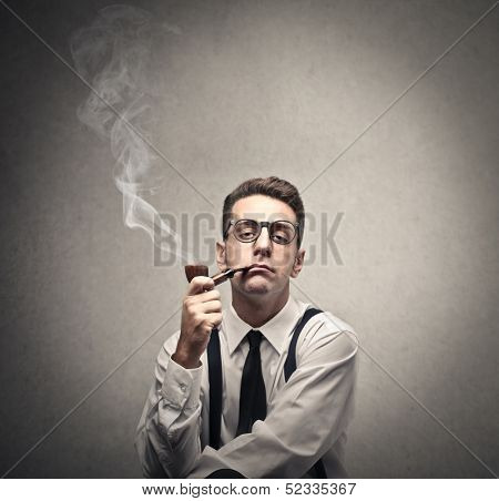 journalist smokes a pipe