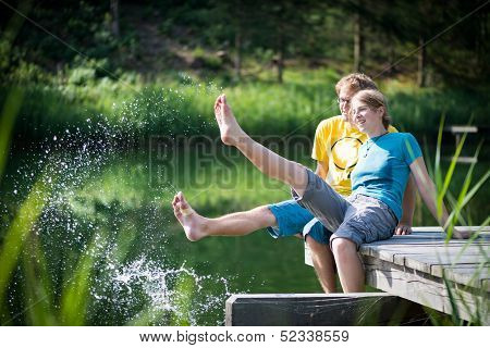 young couple splashing water