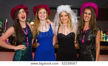 Smiling friends having hen party looking at camera
