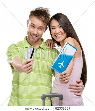 Couple with suitcase, tickets and credit card, isolated on white. Concept of romantic vacations and lovely honeymoon
