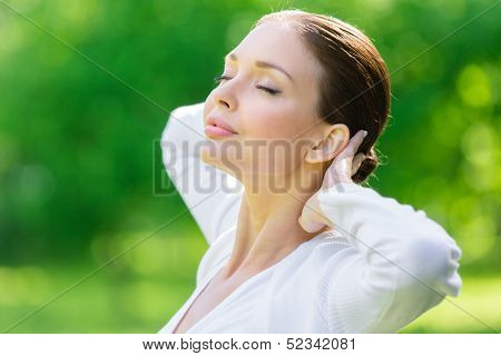 Woman with closed eyes putting hands behind head. Concept of healthy lifestyle and relaxation