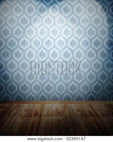 Wooden floor and spotlit wallpaper
