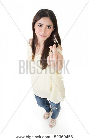 Asian woman give you a sign of fake, full length portrait isolated on white background.