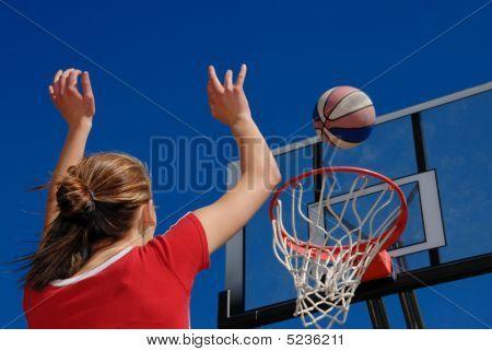 Teen Plays Basketball