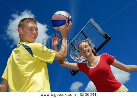 Siblings Playing Basketball