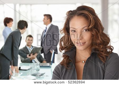 Happy businesswoman on business meeting at office, smiling.