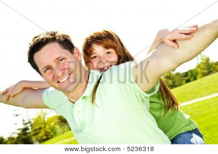 Father And Daughter Piggyback