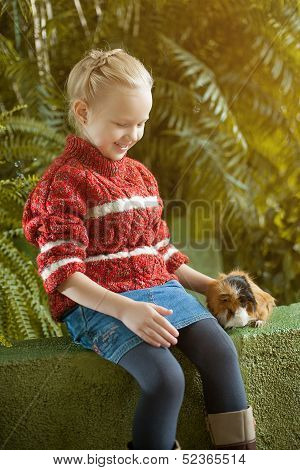 Image of smiling girl posing with cute cavy
