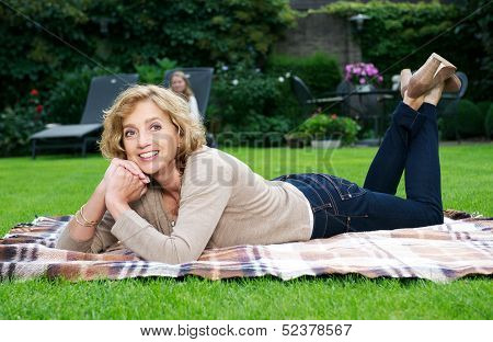Happy Mature Woman Smiling Outdoors