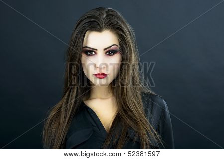 beautiful woman with halloween makeup isolated on black background