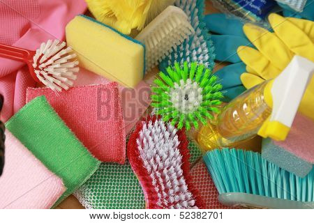 Items for cleaning the house, sponges, brush,  and gloves