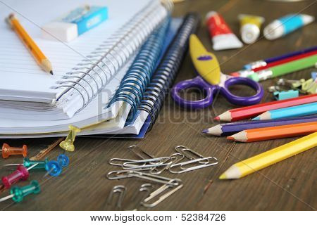 Material for school, paper clips, pencils, colors, scisor and notebook