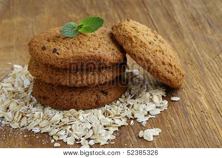 pile of round oatmeal cookies with dry oatmeal