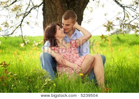 Couple On A Green Meadow