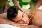 stock photo of massage therapy  - A man getting a massage lying down - JPG
