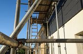 foto of scaffold  - Scaffolding against a house wall - JPG