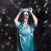 Crazy Doctor Clown Laughing In Rain