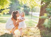 foto of stroll  - Portrait of happy mother and baby playing outdoors - JPG