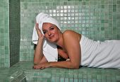 picture of exhale  - woman sitting in a Turkish bath resting - JPG