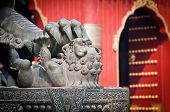 stock photo of lamas  - The bronze lion statue in front of Yonghe Temple also known as Palace of Peace and Harmony Lama Temple or simply Lama Temple in Beijing China - JPG