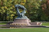 stock photo of chopin  - Polish pianist Frederic Chopin monument in Lazienki Park Warszawa Poland - JPG