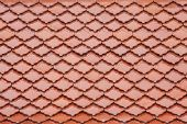 image of red roof tile  - red roof tile have pattern like fish scales - JPG