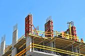 stock photo of reinforcing  - Concrete formwork with a folding mechanism and floor beams on construction site - JPG
