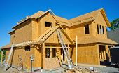 foto of framing a building  - House- Wood Frame Construction.  New Home being built.