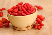 stock photo of barberry  - ripe barberries in wooden bowl - JPG