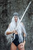 picture of paladin  - Girl with long white hair in chain mail and sword - JPG