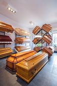 image of funeral home  - Wooden brown coffins in a funeral home - JPG