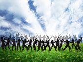image of groupies  - many happy people are dancing on the grass - JPG