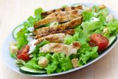 pic of caesar salad  - Fresh caesar salad with chicken breast lettuce and tomatoes.