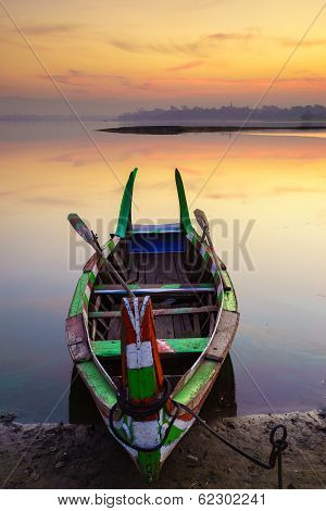 Wooden Boat In Ubein Bridge At Sunrise, Mandalay, Myanmar