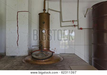 Fragment of copper boiler in distillery