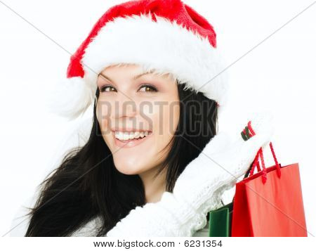 Woman In Christmas Clothes Holding Shopping Bags Over White