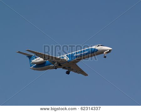 Dniproavia Airlines Embraer ERJ-145EU aircraft on the blue sky background