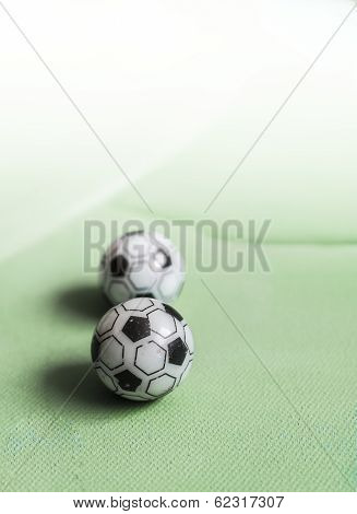 Two Toy Footballs