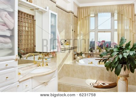 Golden bathroom interior in romantic style