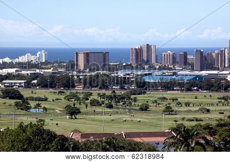 City Skyline With Golf Course And Ocean