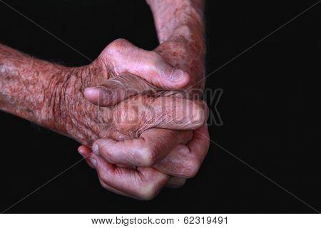 Portrait of a Senior Mans Hands on black background