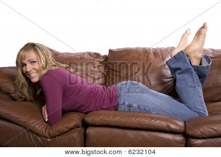 Woman On Couch Feet Up