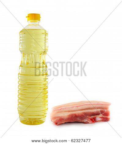 Vegetable Oil In A Plastic Bottler And Raw Pork