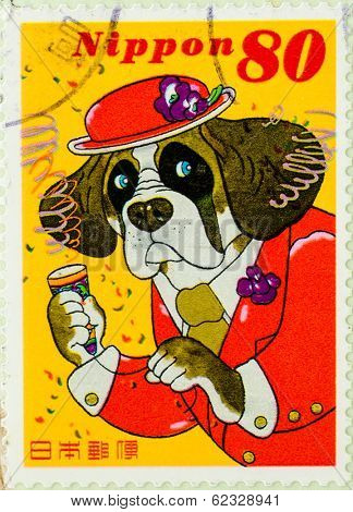 JAPAN - CIRCA 1990th: A stamp printed in japan shows animated dog in a hat, circa 1990h