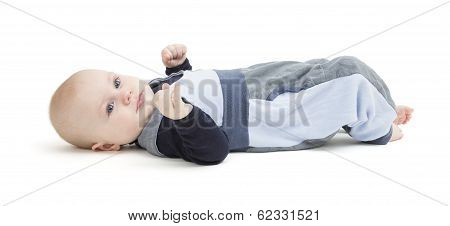 Smiling Toddler Laying On His Back