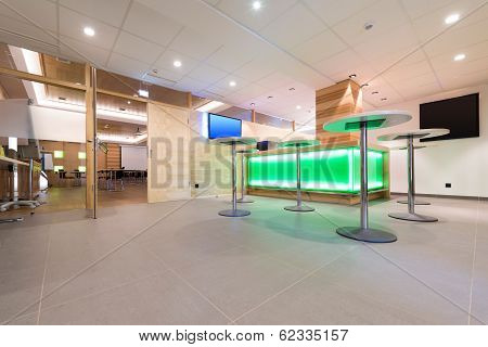 low view to wooden foyer with illuminated bar desk