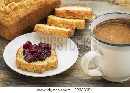 gluten free breakfast - bread made with coconut and almond flour, and flax meal, sugar free cranberry sauce with blueberries and coffee